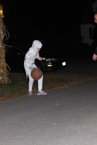 Balancing an eyeball on a spoon while bouncing a basketball.