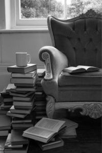 books stacked by a chair